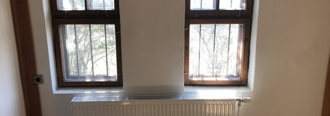 Heating with pellet stove of a house Revival style